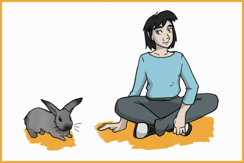 sitting with a rabbit
