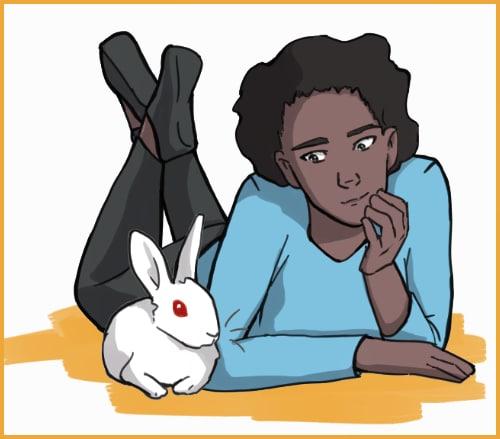 Lying next to a rabbit